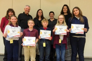Spelling bee winners recieveing their awards